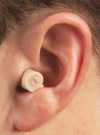 Rolled up earplug in ear